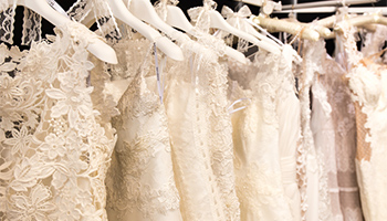 White wedding dresses on hangers