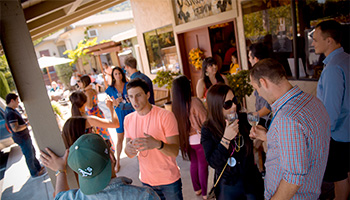 People talking and laughing at Fortino Winery
